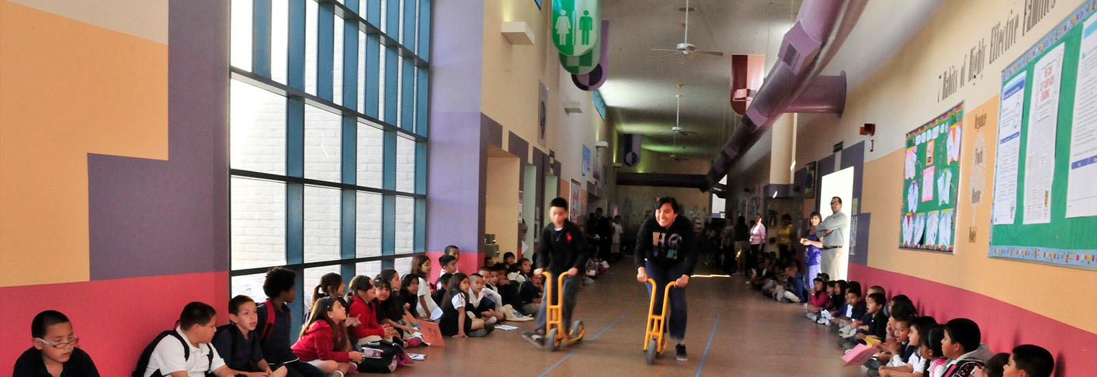 Students celebrate perfect attendance with hall-way races.