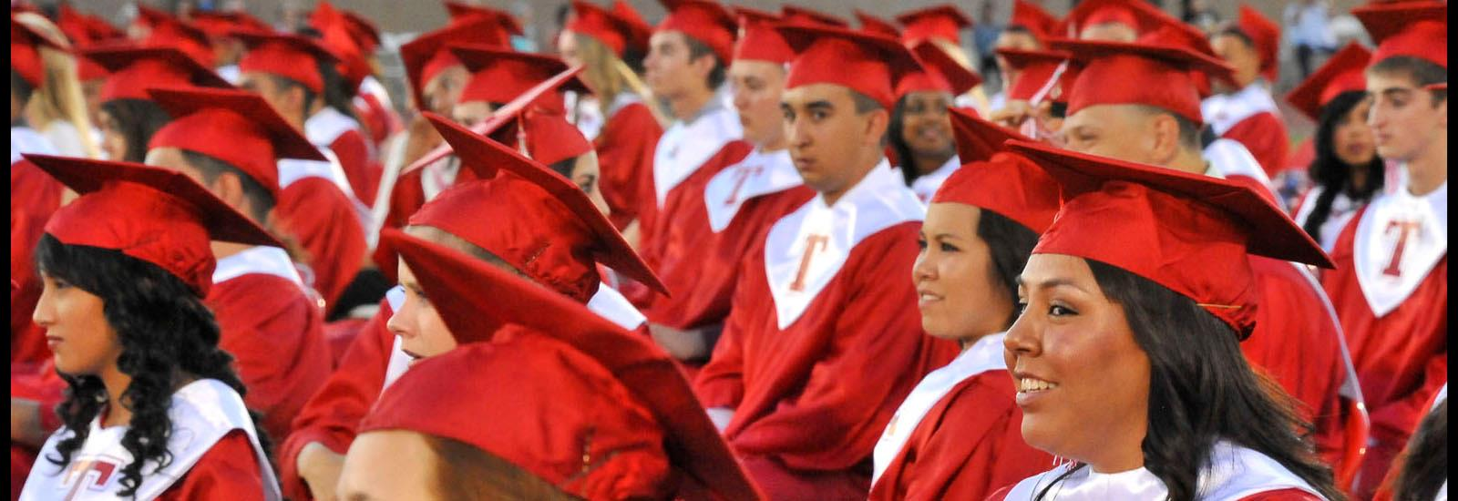 The largest graduating class in the district forms a sea of red.