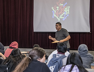 Photo of Dr. Villegas speaking with students