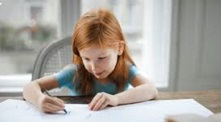 Photo of girl working at desk