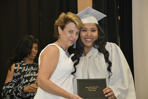 Ana Cobos Receiving Her Diploma with Principal Anne Dudley