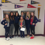 students with pennant wall