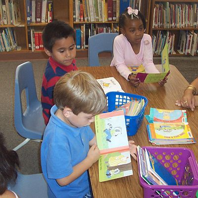 Three students with picture books