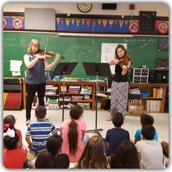 students playing violins