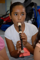 Photo of student playing recorder