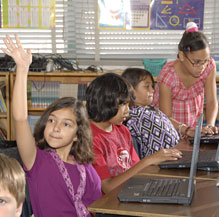 Image of Brichta students working with laptops