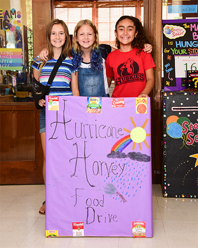 Sam Hughes 5th graders with their donation box