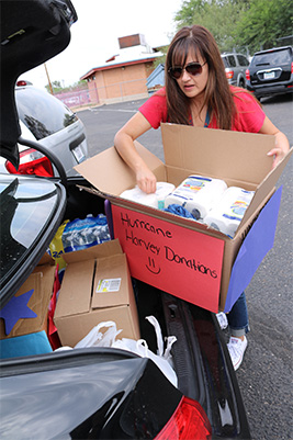 A Pueblo Gardens staffer puts donations in the car to take to the University of Arizona.