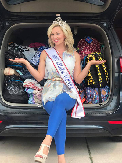 Mrs. Arizona with backpacks donated by Soleng Tom.