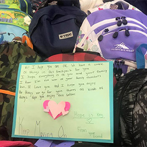 Donated backpacks with a heartfelt message for hurricane survivors.