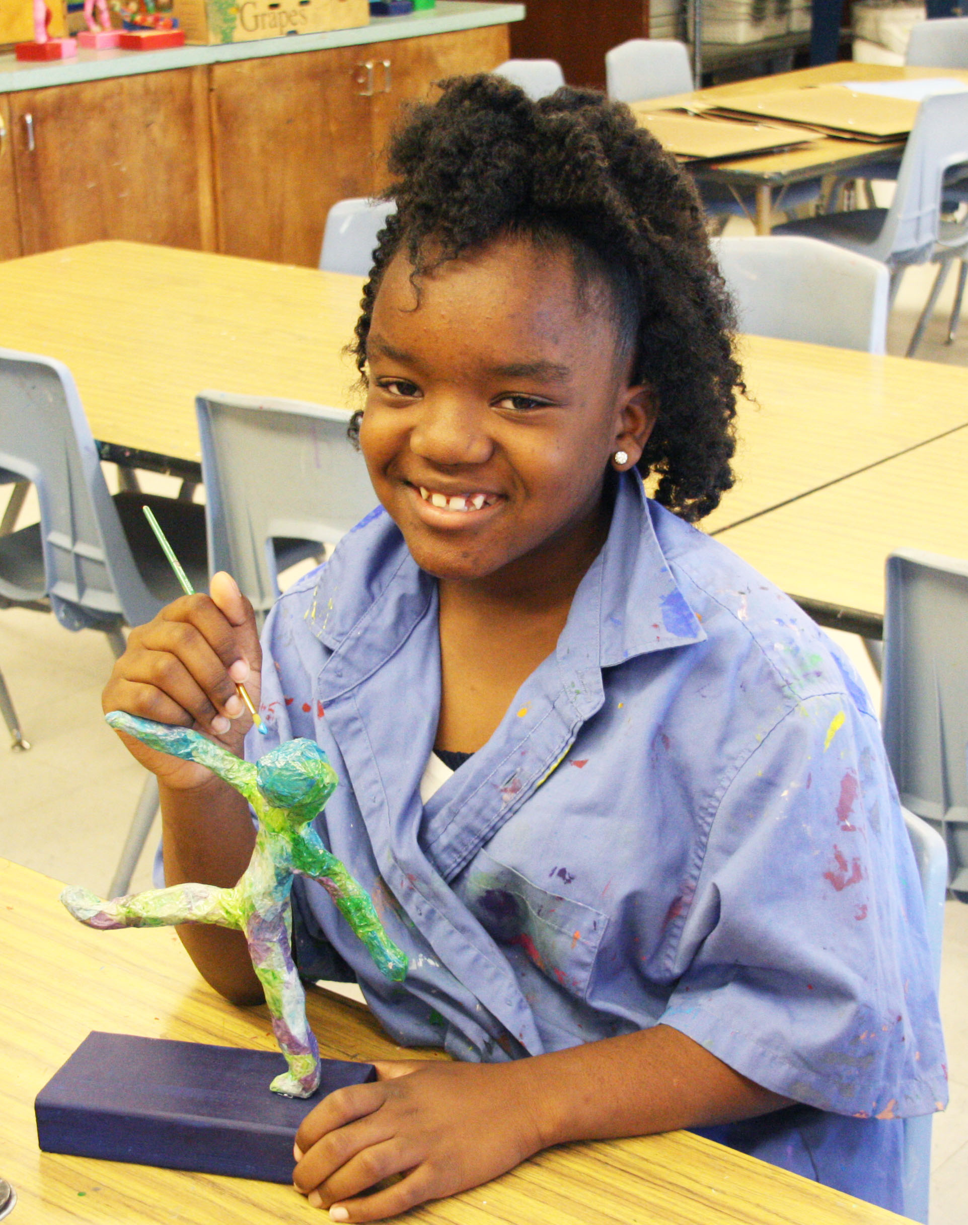 Carrillo Student working on sculpture of body