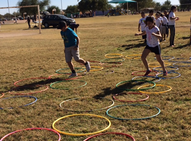 Students running through obstacles