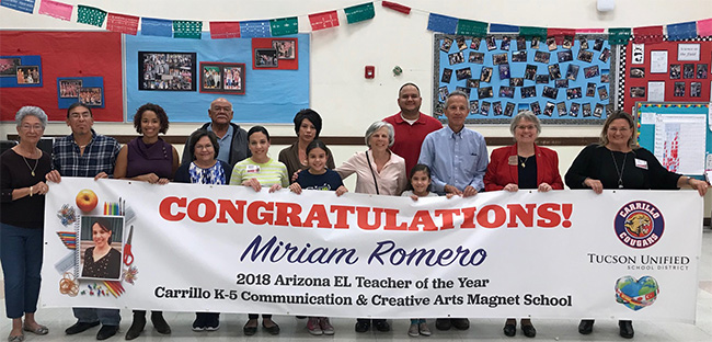 Photo of School Staff with Congratulations Banner